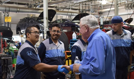 Mr Holman meeting Kuni Honda Service technicians
